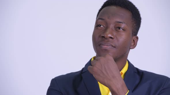 Thumbnail for Face of Young Happy African Businessman in Suit Thinking