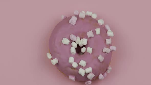 Sweet Donut Rotating on Pink Background. Top View. Tasty, Fresh Donut