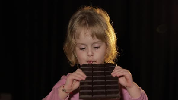Thumbnail for Attractive Child Eating a Huge Block of Chocolate
