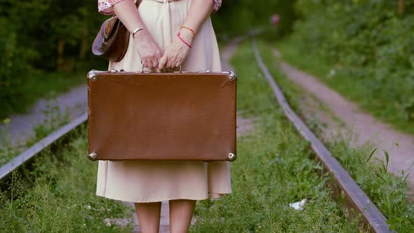 Thumbnail for Female Hands Holding Vintage Suitcase on Railway Background at Summer. Tourist Woman with Retro