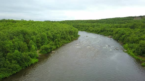 Thumbnail for Aerial Shoot of Clean River in Green Forests and Hills in Wild Kola Peninsula Areas