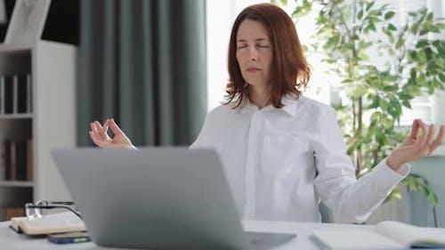 Woman Meditating at Workplace