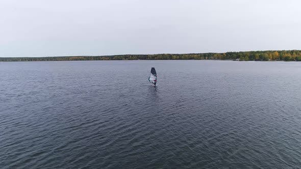 Thumbnail for Aerial drone shot of alone windsurfer at big pond