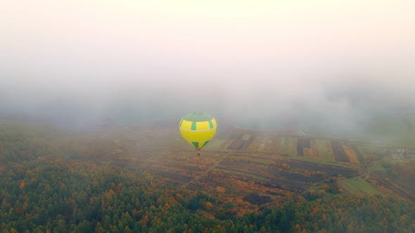 Thumbnail for Aerial View on Top Balloon Flight on a Cloudy Foggy Day. Gloomy Winter Day Balloon Blown Away By the