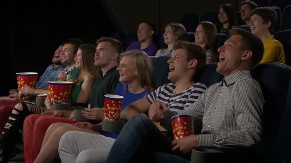 Thumbnail for Cinema, Entertainment and People - Happy Friends Watching Movie in Theater