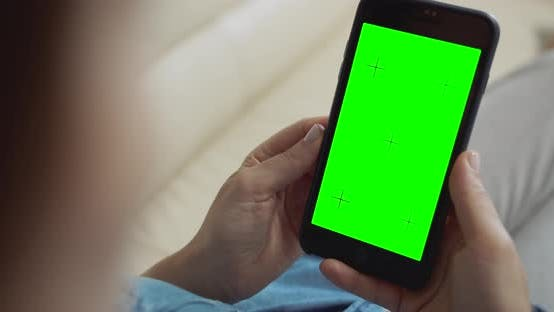 Thumbnail for Woman Holding Greenscreen Smartphone