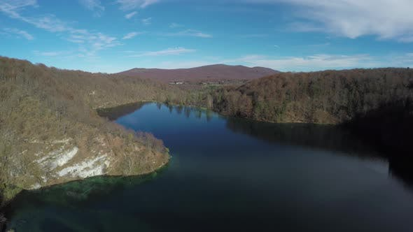 Thumbnail for Aerial shot of lake surrounded by hills, Plitvice Park