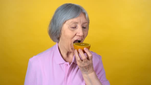 Thumbnail for Elderly Woman Eating Orange