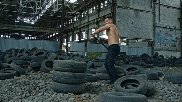 Thumbnail for Sportsman with a heavy hammer in old plant.