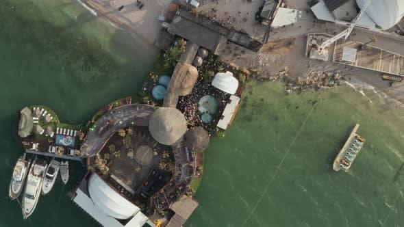Thumbnail for AERIAL: Birdsview of People Dancing Partying at Beautiful Beachclub in Novalja, Croatia with Ocean