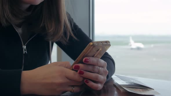 Thumbnail for Girl With Phone Waiting For Flight