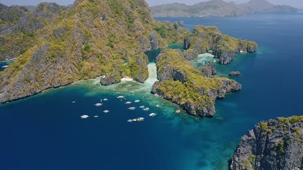 Thumbnail for Aerial View of Rugged Miniloc Island. El-Nido, Palawan. Philippines. Tourist Boats Moored in Front