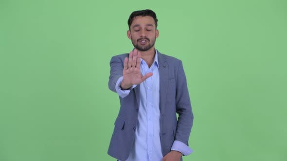Thumbnail for Serious Young Bearded Persian Businessman with Stop Gesture