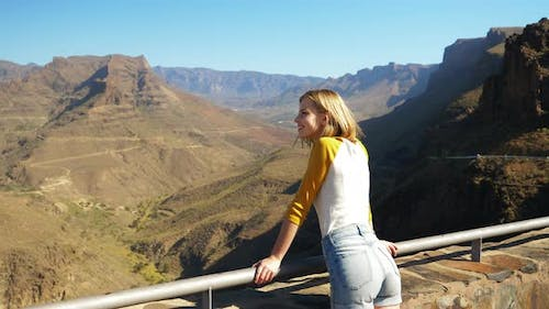 Blonde Female Model at the View Point Admiring the Gran Canaria Landscape