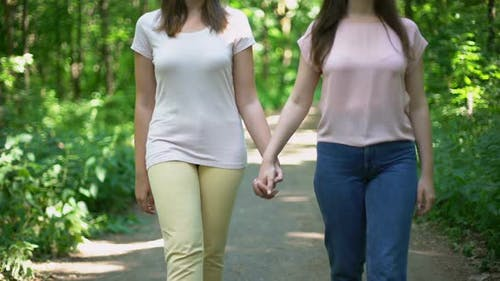 Lesbian Couple Walking Together, Holding Hands, Free Choice of Love No Prejudice