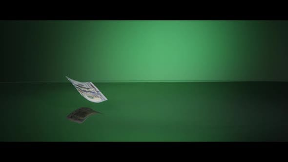 American $100 Bills Falling onto a Reflective Surface - MONEY 0023