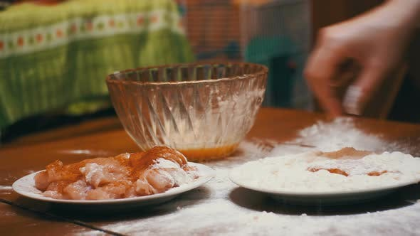 Thumbnail for Piece of Meat Falls on a Plate of Flour in Home Kitchen
