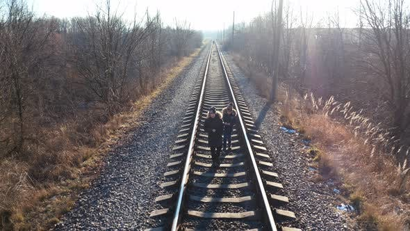 Thumbnail for Two Little Boys Walking on a Railroad.