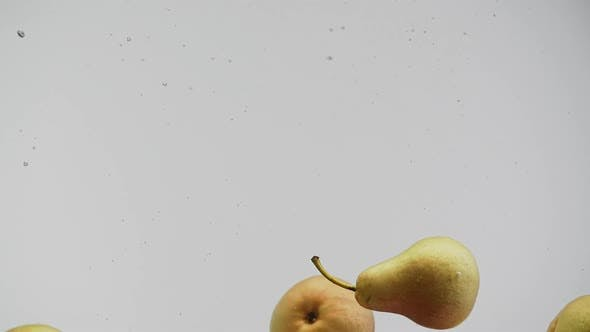 Thumbnail for Pears Falling Into Water and Rotating with Splash and Air Bubbles White Background