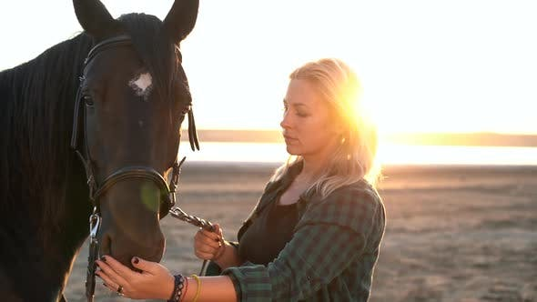 Portrait of Adult Woman with Beautiful Horse in Nature, Sunlight, Silhouette