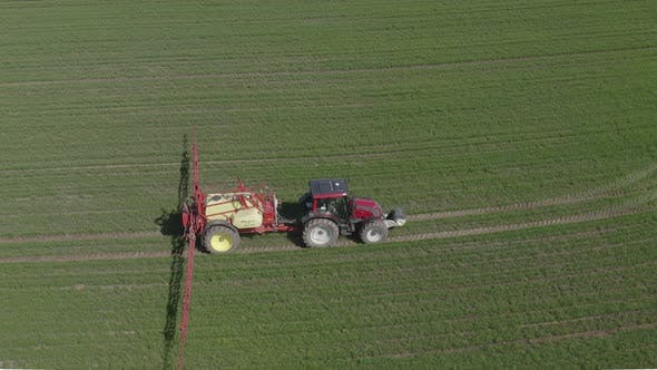 Thumbnail for Tractor Sprays Fertilizers over Crop Field
