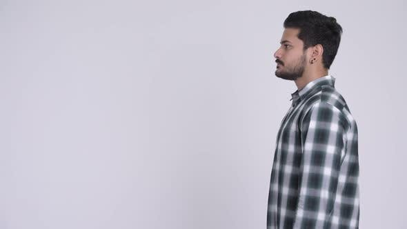 Cover Image for Profile View of Young Handsome Bearded Indian Man