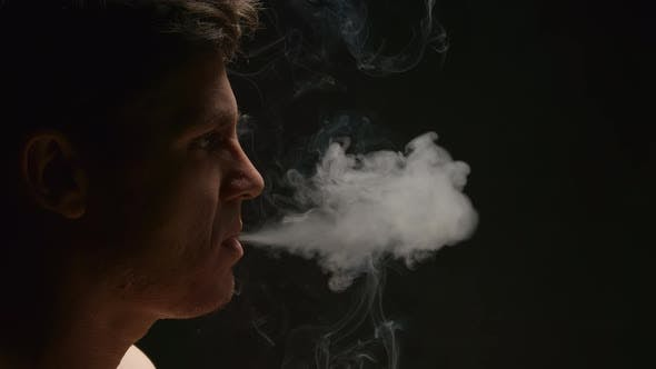 Thumbnail for Smoker exhales out a smoke