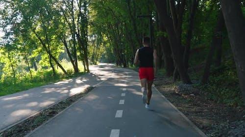 Slow Motion Man Jogging on Bike Lane