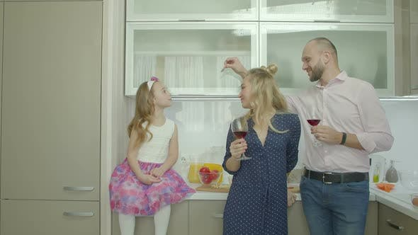 Playful Family Enjoying Leisure in Domestic Kitchen