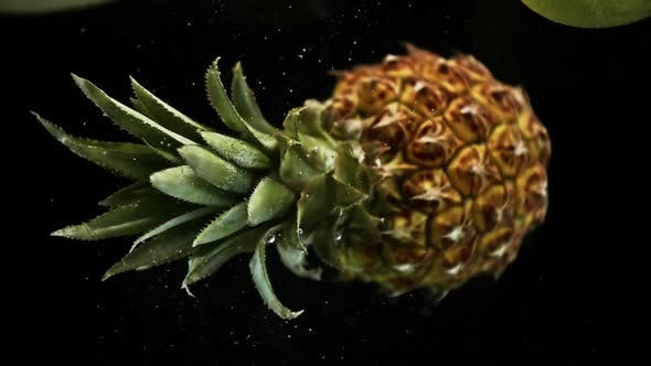 Thumbnail for Pineapple Under Water Ratating on Black Background