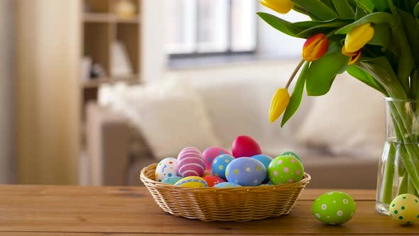 Thumbnail for Colored Easter Eggs in Basket and Flowers at Home