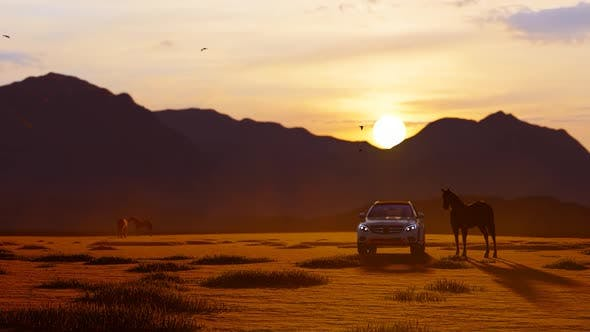 Thumbnail for White Luxury Off-Road Vehicle Coming from Horses in Mountainous Area with Sunset View