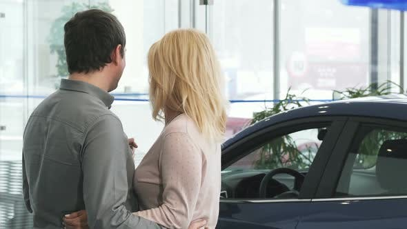 Thumbnail for Rearview Shot of a Mature Couple Examining a New Car at the Dealership 1080p