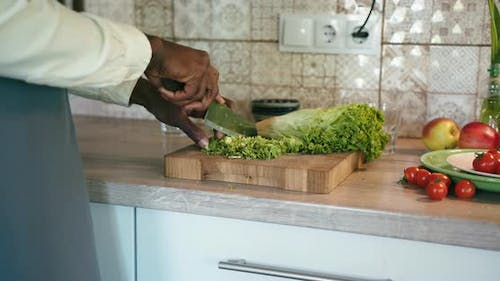Closeup Young Black Man Cut Vegetables Cook in Kitchen