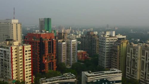 Forward Aerial Pan of Tall Buildings in New Delhi on a Foggy Day