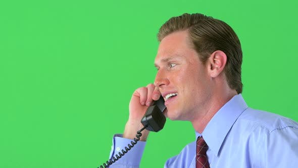 Thumbnail for Businessman working on tablet on greenscreen