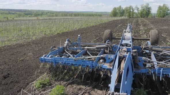 Thumbnail for Disking the soil. Short disc harrow.