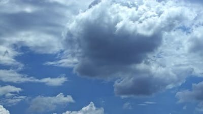 Stunning Huge Cumulus Clouds Swirl in the Daytime