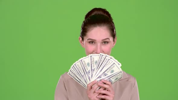 Thumbnail for Girl with Banknotes of Money in Her Hands, Winks at the Guy She Likes. Green Screen