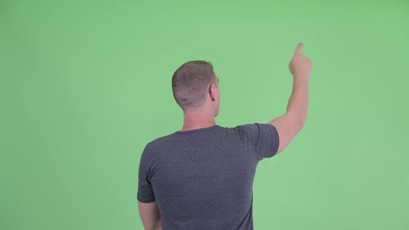 Thumbnail for Rear View of Young Man Pointing Finger