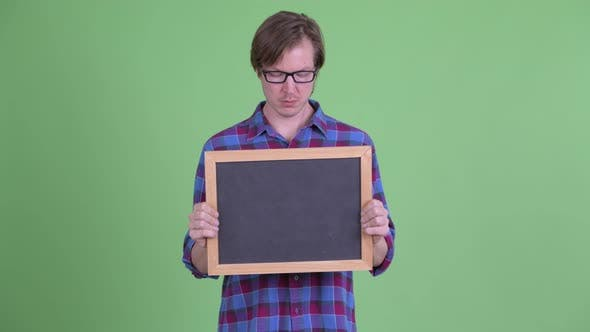 Thumbnail for Young Handsome Hipster Man Holding Blackboard