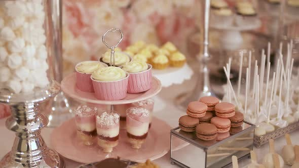 Thumbnail for Cute Candy Bar with Various Cakes and Candies. Wedding Candybar.
