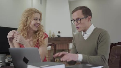 Portrait of Cute Young Man with Glasses Enthusiastically Tells a Story of a Beautiful Seductive Girl