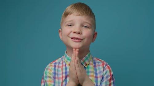Preschool Pleading Boy Isolated on Blue Background