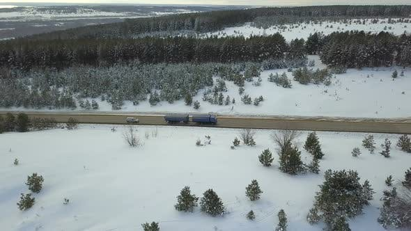 Thumbnail for Truck And Car On Winter Country Road