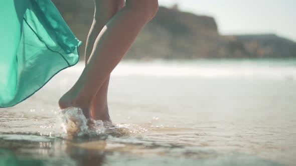 Thumbnail for Female Bare Feet Standing on the Wet Sand on the Beach. Female Legs Posing in the Sun at a Seaside