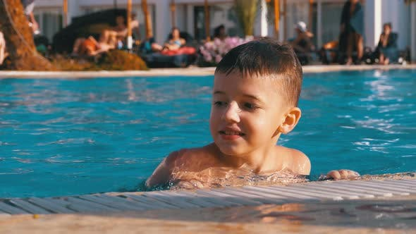 Thumbnail for Happy Boy Playing in a Pool with Blue Water