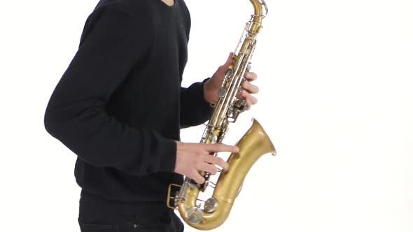 Thumbnail for Solo Saxophone. Playing Young Musician Man in a White Studio