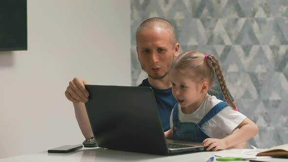 Thumbnail for Positive Father and Girl Do Homework on Modern Computer