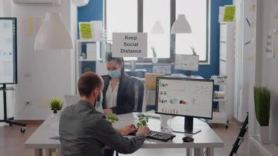 Businesspeople Analysing Financial Graphics While Working After Lockdown